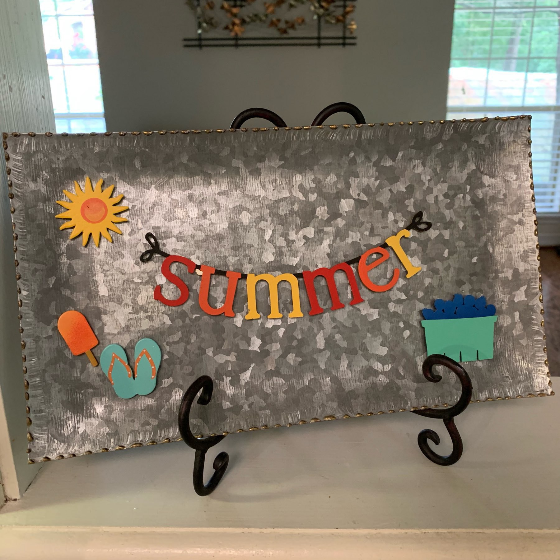 Magnetic board with sun, ice cream, sandles, and blueberry magnets