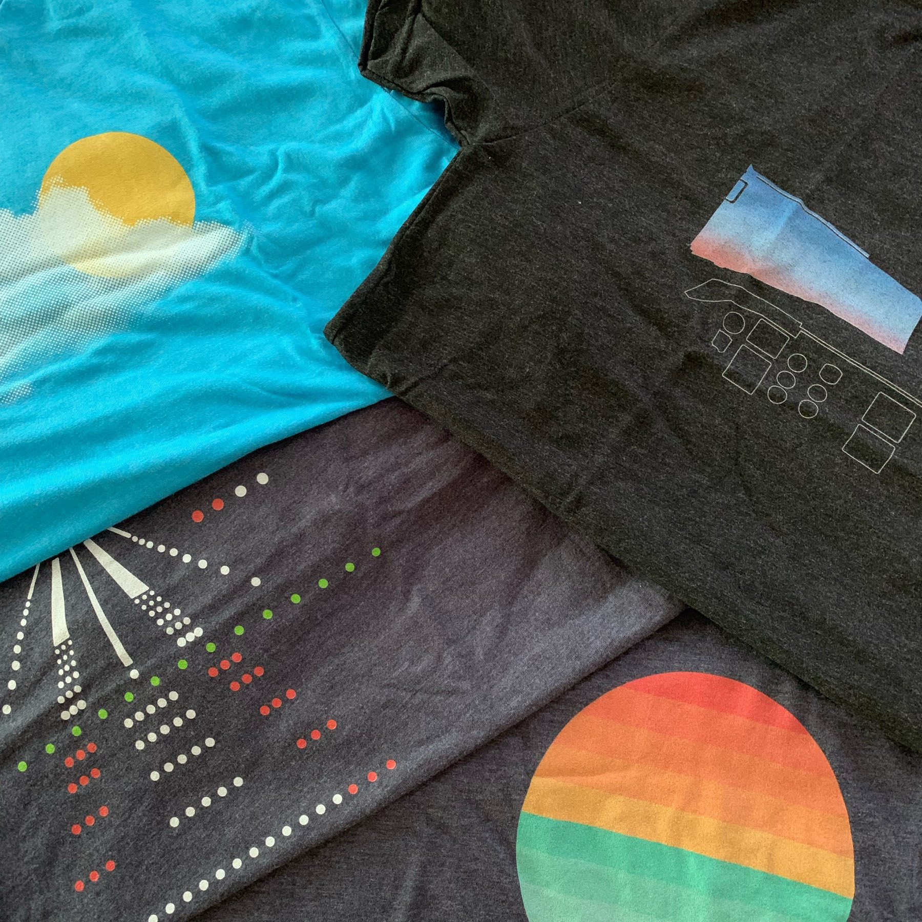 New shirts laid out on a flat surface.