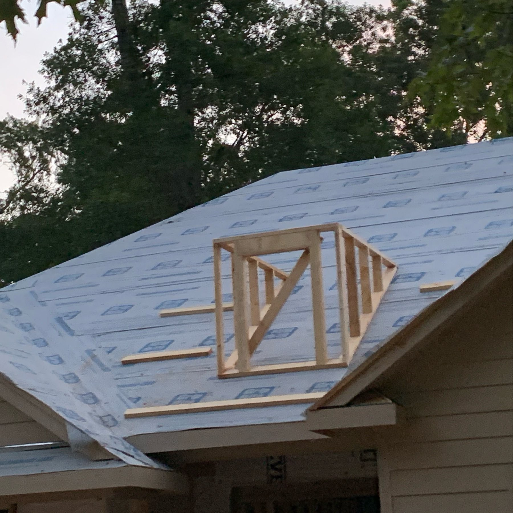 Fake window framed on roof of new home construction