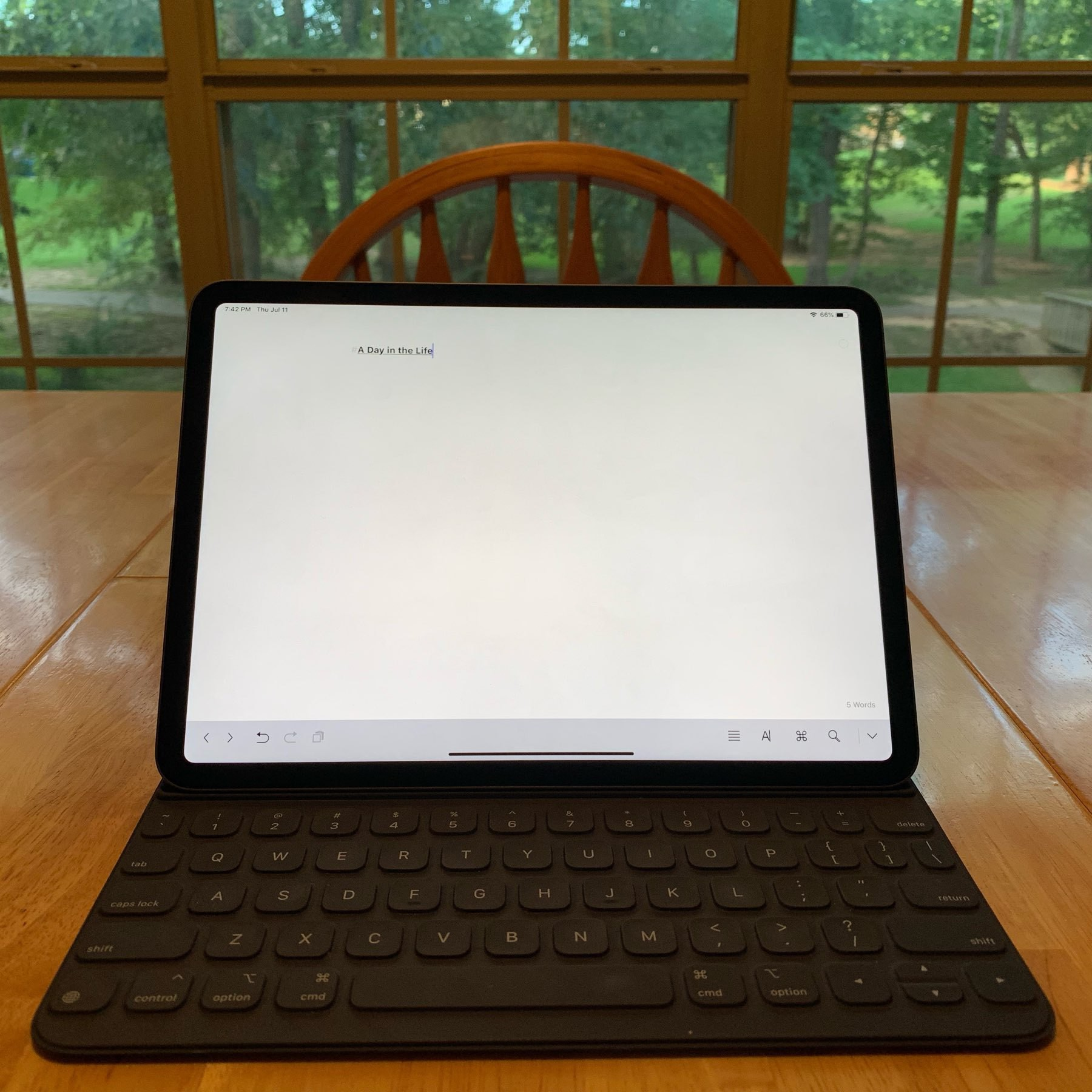 iPad on table with blank sheet open in Ulysses app