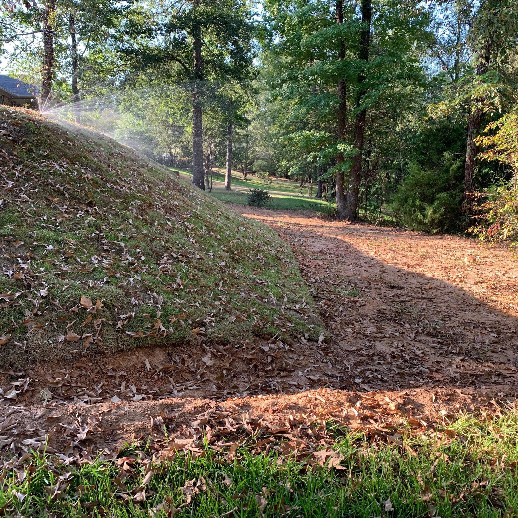 New house back yard on steep incline