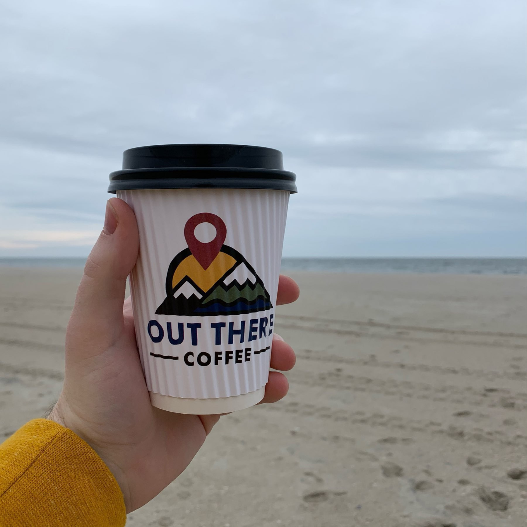 Coffee cup in foreground, Atlantic Ocean in the background.