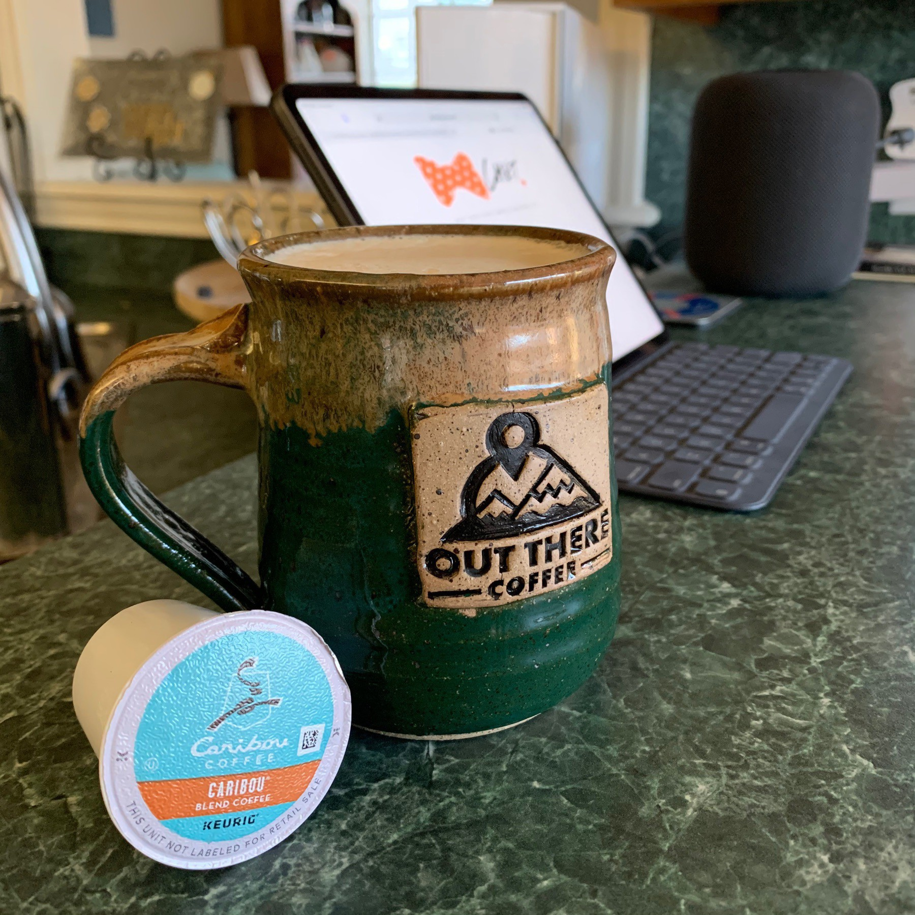 Mug and K Cup sit on a countertop