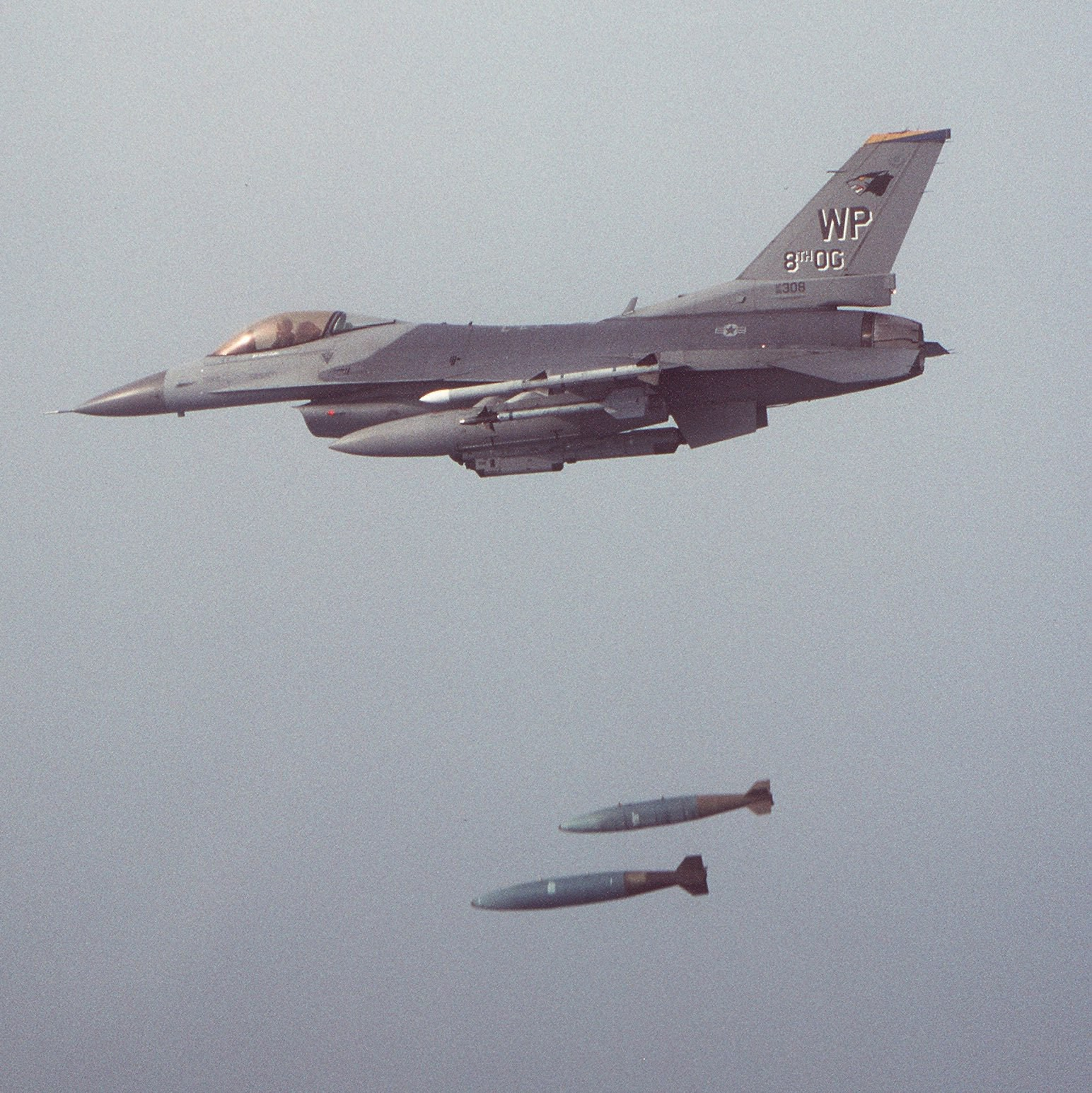 F-16 dropping a pair of bombs.