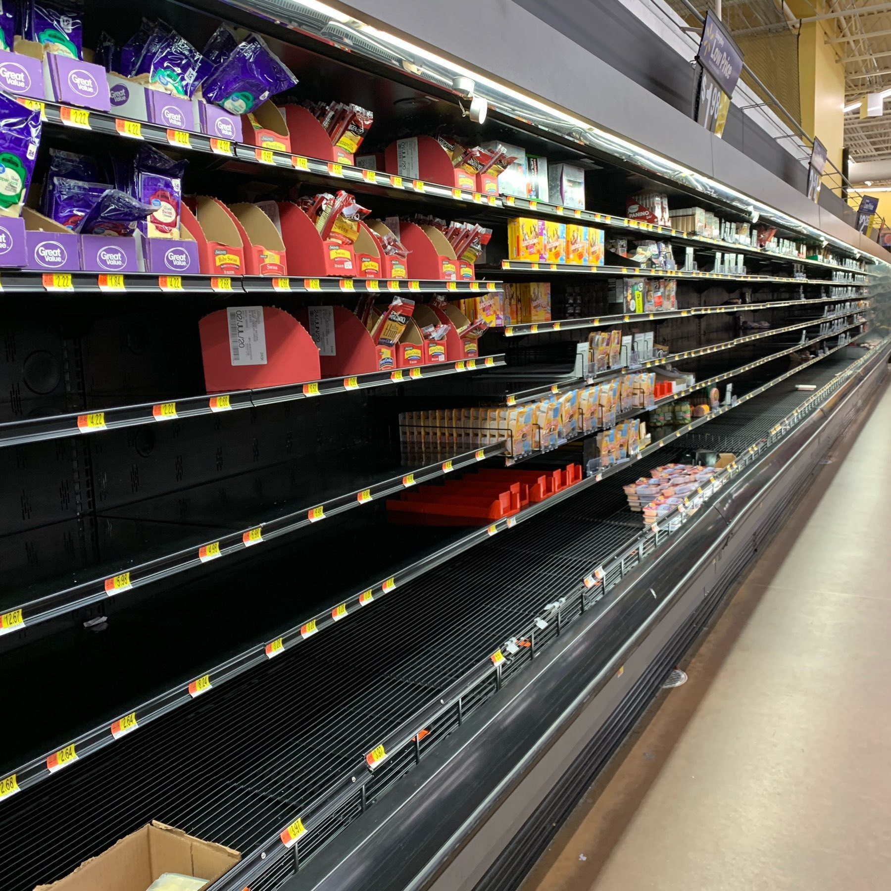 Empty dairy shelves