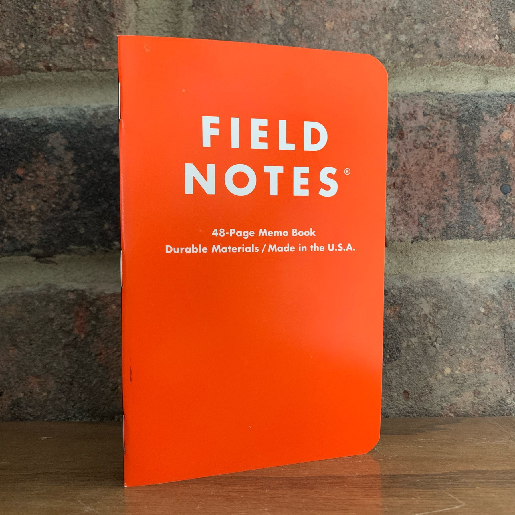 Orange cover on Field Notes notebook.
